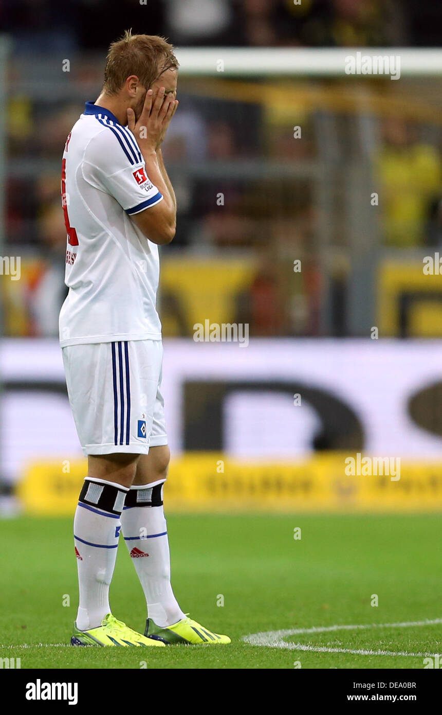 Dortmund, Germany. 14th Sep, 2013. Hamburg's Maximilian Beister reacts after a goal during the German Bundesliga match between Borussia Dortmund and Hamburger SV at Signal-Iduna-Park in Dortmund, Germany, 14 September 2013. Photo: FRISO GENTSCH (ATTENTION: Due to the accreditation guidelines, the DFL only permits the publication and utilisation of up to 15 pictures per match on the internet and in online media during the match.)/dpa/Alamy Live News - Stock Image