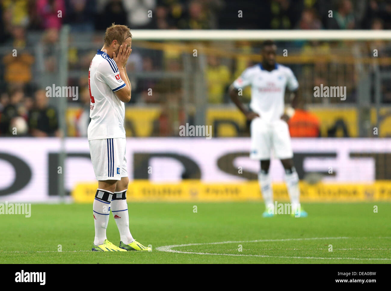 Dortmund, Germany. 14th Sep, 2013. Hamburg's Maximilian Beister (L) reacts after a goal during the German Bundesliga match between Borussia Dortmund and Hamburger SV at Signal-Iduna-Park in Dortmund, Germany, 14 September 2013. Photo: FRISO GENTSCH (ATTENTION: Due to the accreditation guidelines, the DFL only permits the publication and utilisation of up to 15 pictures per match on the internet and in online media during the match.)/dpa/Alamy Live News - Stock Image