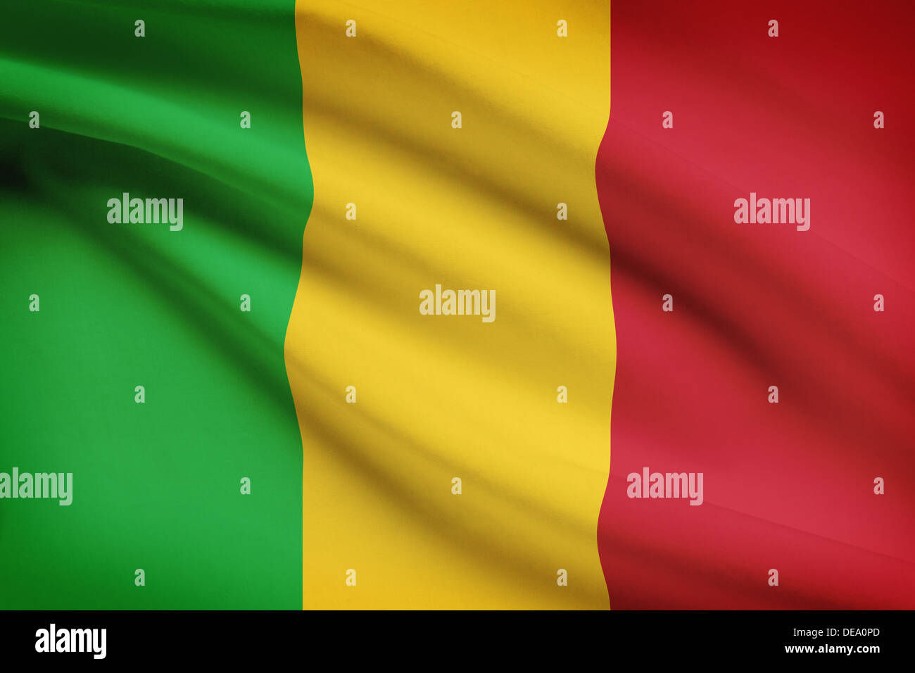 Malian flag blowing in the wind. Part of a series. - Stock Image