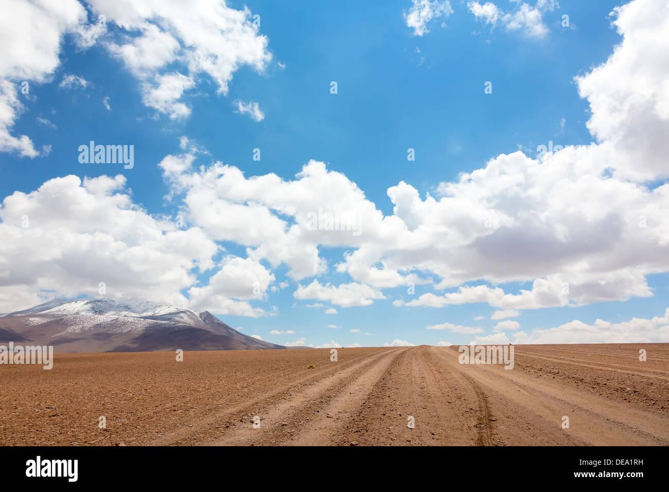 Unpaved road in Bolivian altiplano - Stock Image