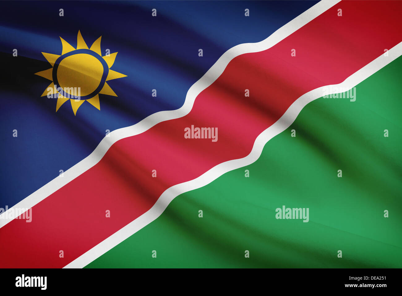 Namibian flag blowing in the wind. Part of a series. - Stock Image