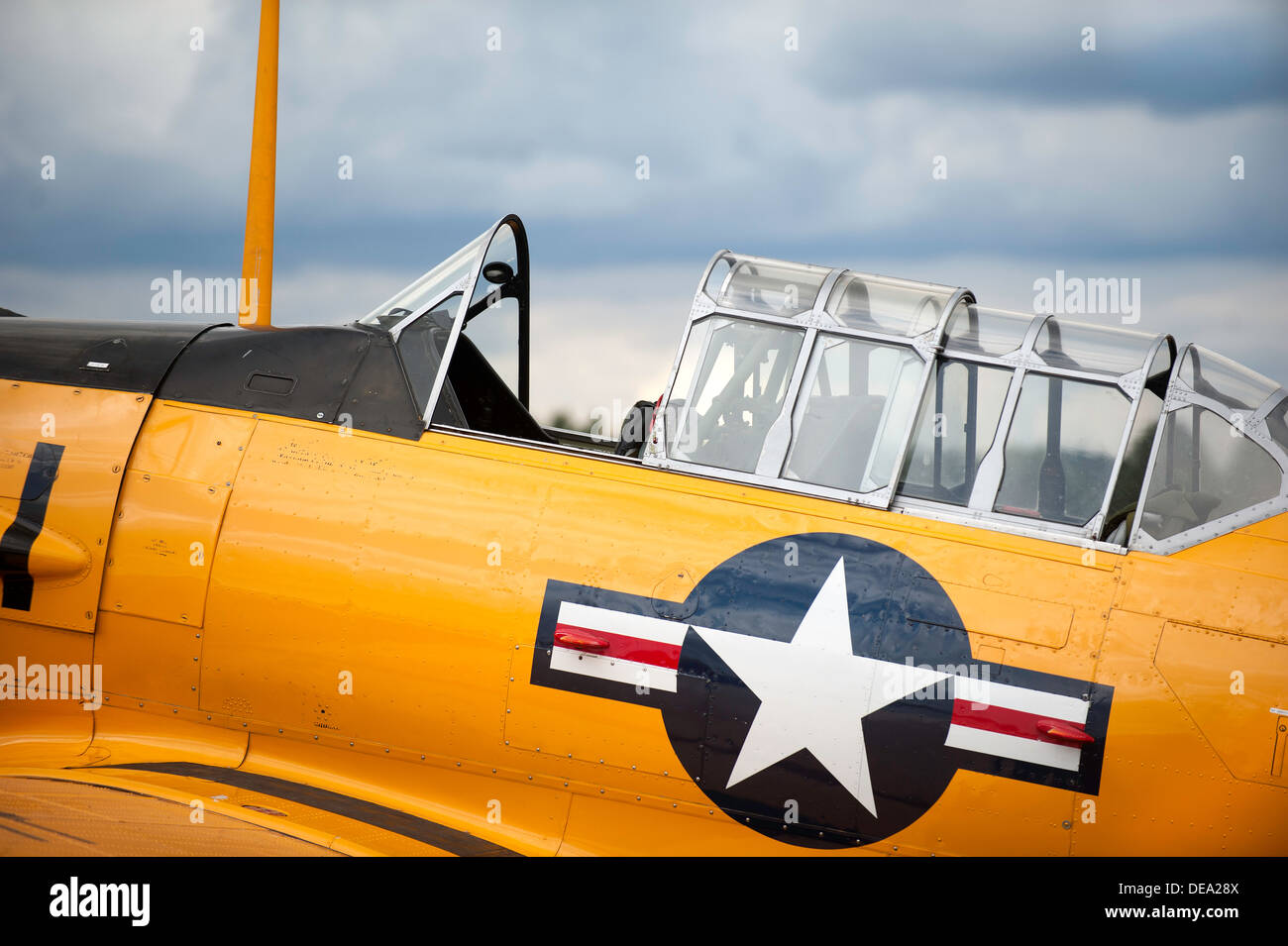 Vintage airplane cockpit with yellow fuselage - Stock Image