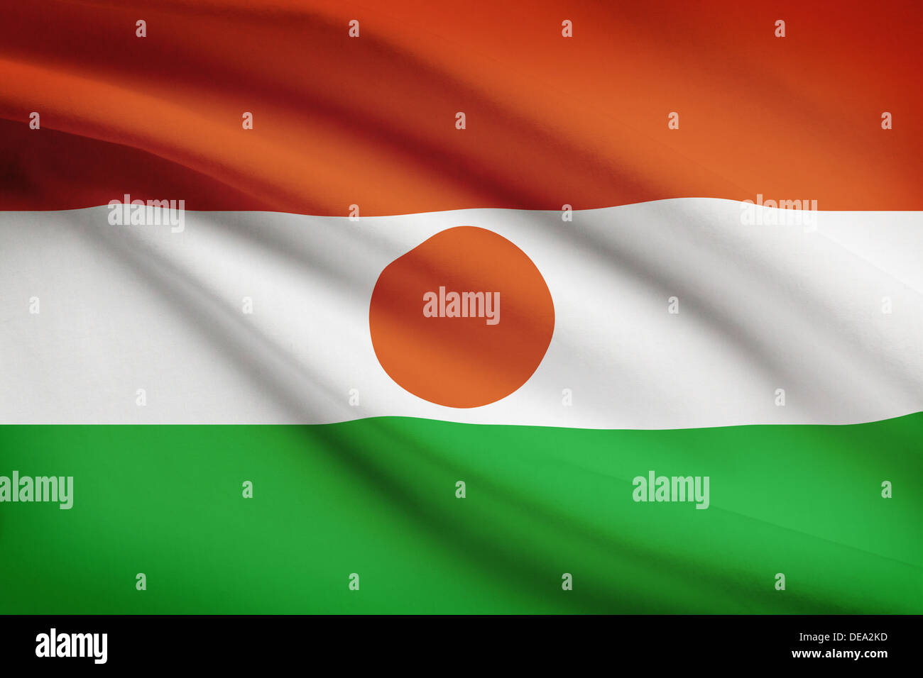 Nigerien flag blowing in the wind. Part of a series. - Stock Image
