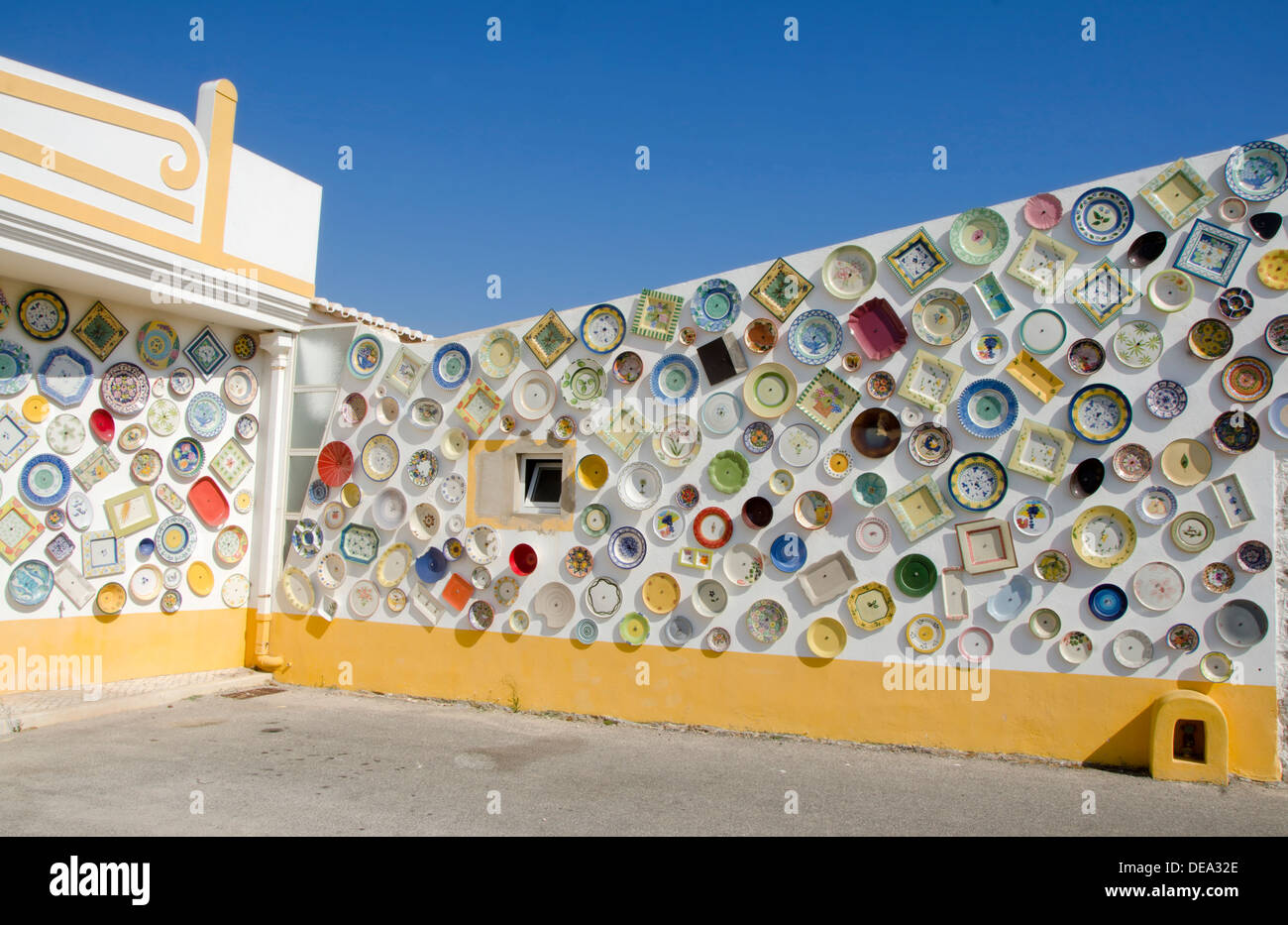 Portuguese pottery and ceramic shop with plates on wall Cape St. Vincent Sagres Algarve Portugal & Portuguese pottery and ceramic shop with plates on wall Cape St ...