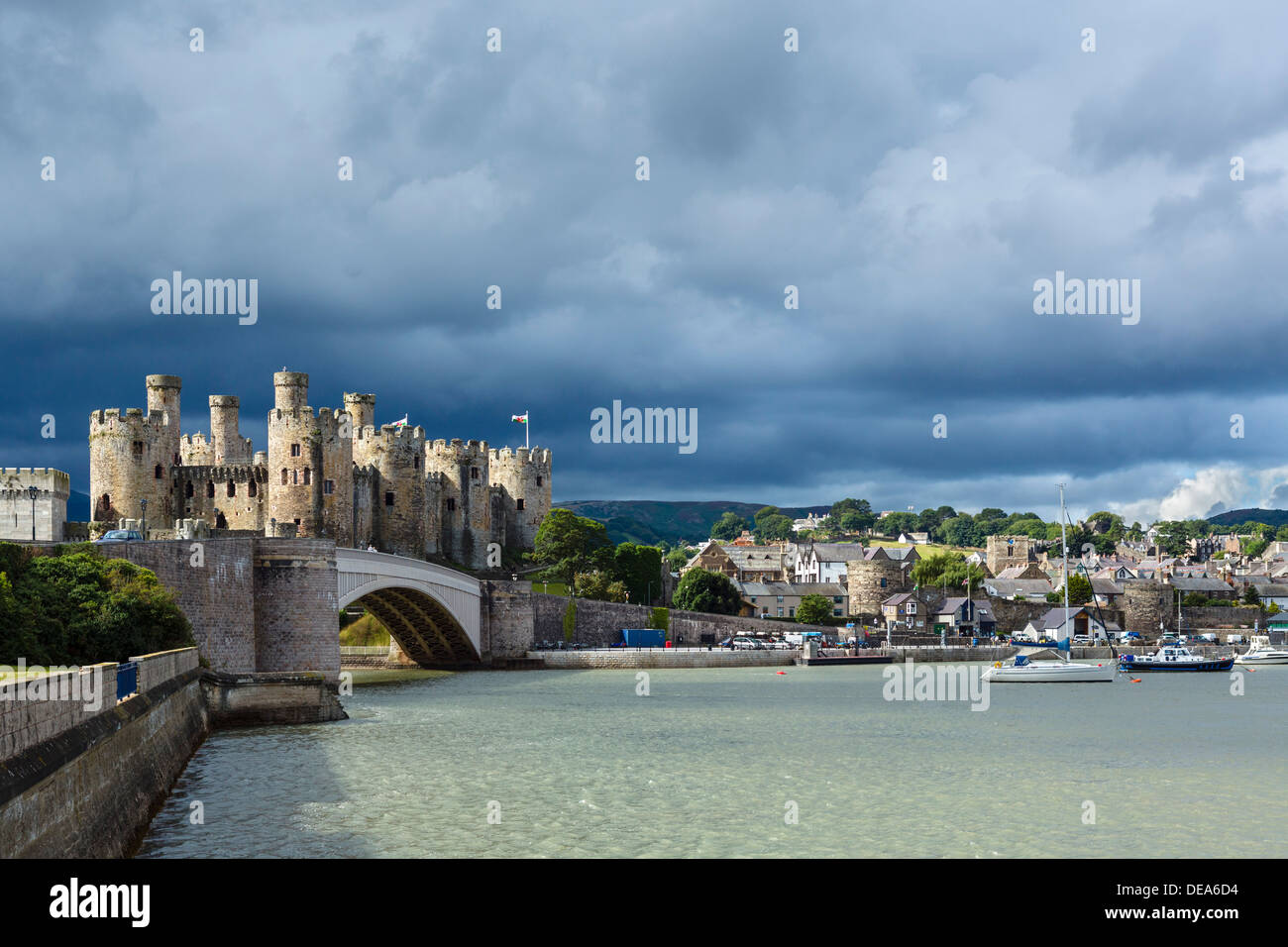 View of Conwy Castle and harbour on the river estuary, Conwy, North Wales, UK - Stock Image