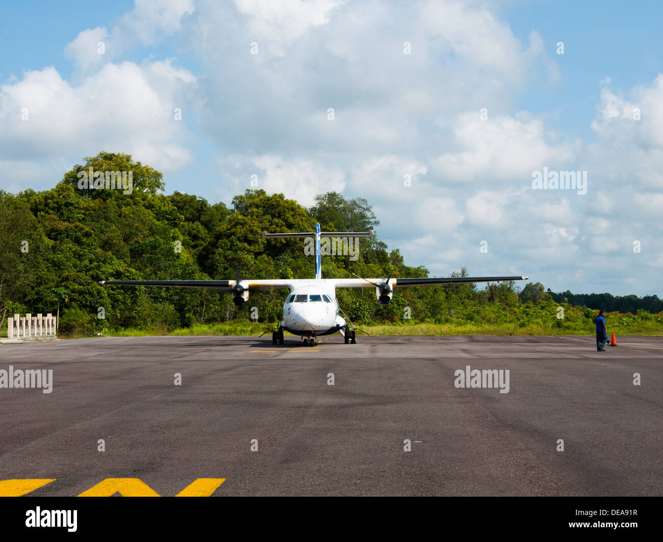 Small airplane stopped at Kalimantan airport - Stock Image