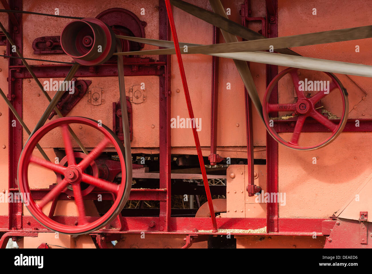 Close-up of steam powered threshing machine, Haddenham Steam Rally, Cambridgeshire - Stock Image