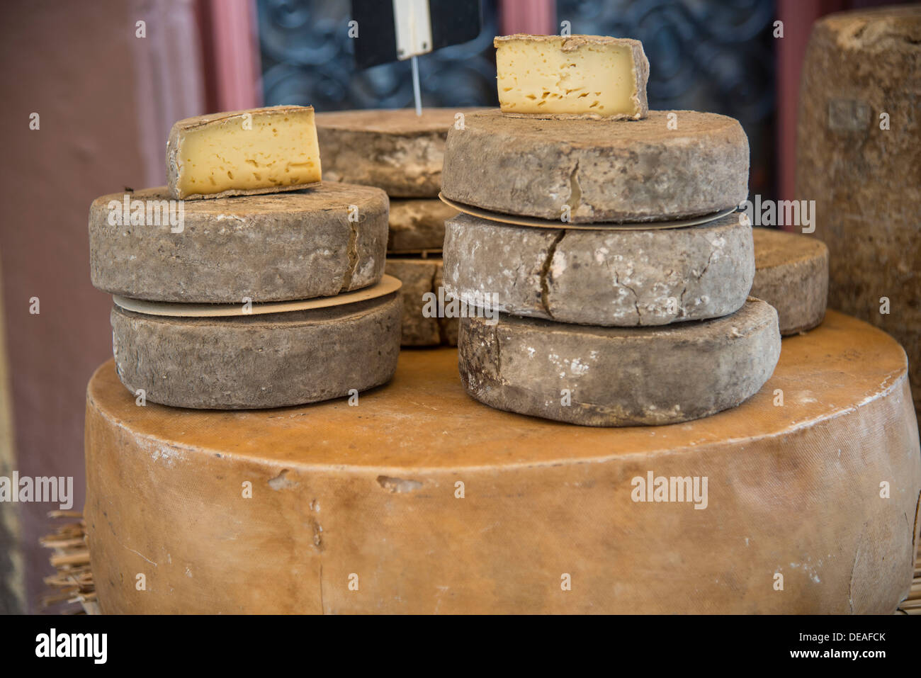 Cheeses for sale on a market, Ribeauville, Département Bas-Rhin, Alsace, France - Stock Image