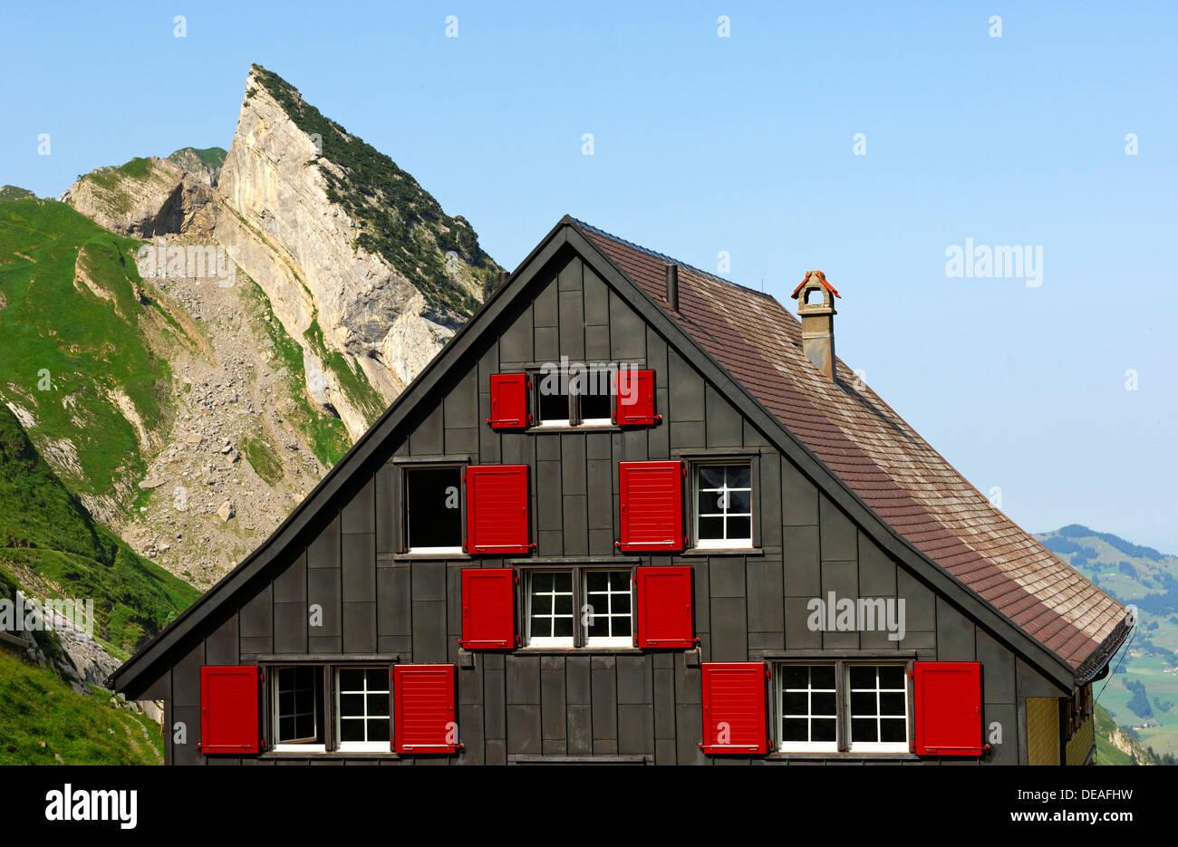 House on a mountain, rear side of the Mesmer Mountain Inn, Weissbad, Alpstein, Appenzell Innerrhoden, Switzerland, Europe - Stock Image