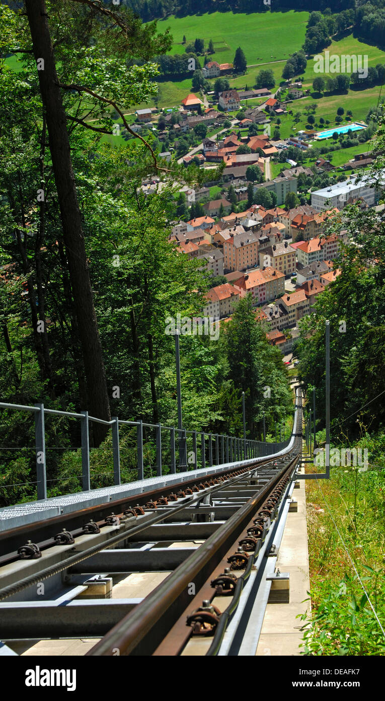 View into the valley from the rising tracks of the funicular between Mont Soleil and Saint Imier, with houses of St. Imier in - Stock Image