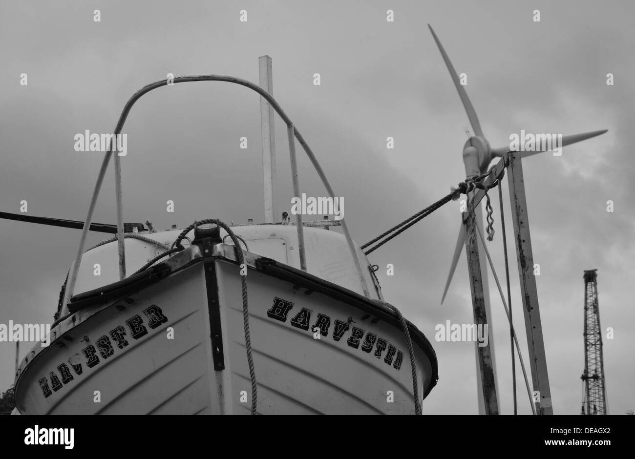 boat and wind turbine in erith yacht club in kent Stock Photo