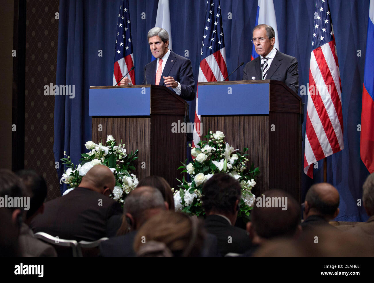 US Secretary of State John Kerry and Russian Foreign Minister Sergey Lavrov hold a news conference after they finalized a framework for the elimination for Syrian chemical weapons September 14, 2013 in Geneva, Switzerland. - Stock Image