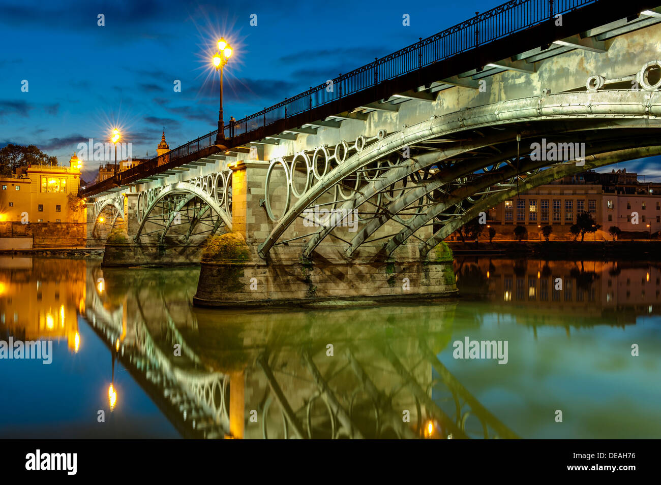 Triana Bridge Sevilla at dusk - Stock Image
