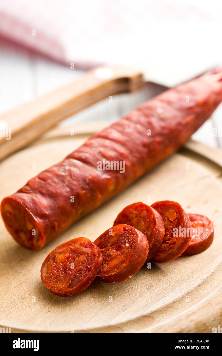 the sliced tasty chorizo sausage - Stock Image