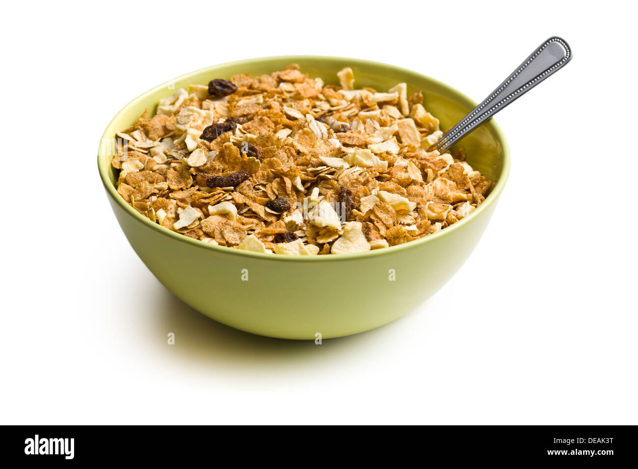 crunchy muesli in bowl on white background - Stock Image