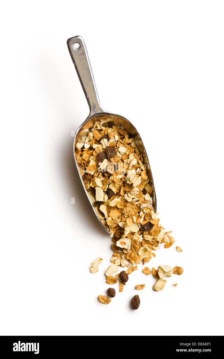 crunchy muesli in scoop on white background - Stock Image