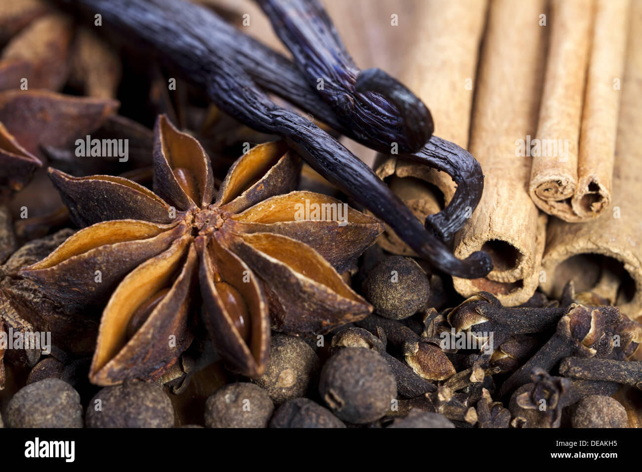 Assortment of Christmas spices on wooden Board as Close Up View - Stock Image