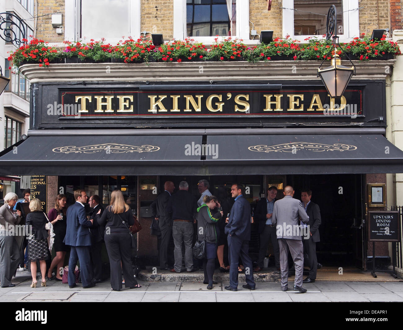 London Pub, crowd outside on a warm summer evening - Stock Image