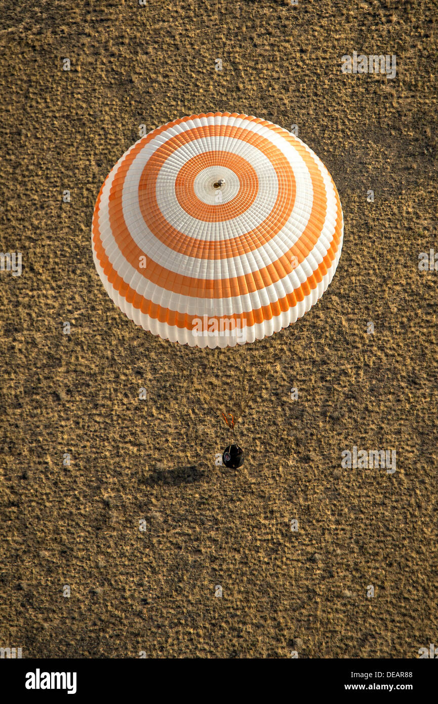 The Soyuz TMA-08M spacecraft with Expedition 36 Commander Pavel Vinogradov and Flight Engineer Alexander Misurkin of the Russian Federal Space Agency, and Flight Engineer Chris Cassidy of NASA aboard lands in a remote area September 11, 2013 near the town of Zhezkazgan, Kazakhstan. Vinogradov, Misurkin and Cassidy returned to Earth after five and a half months on the International Space Station. - Stock Image