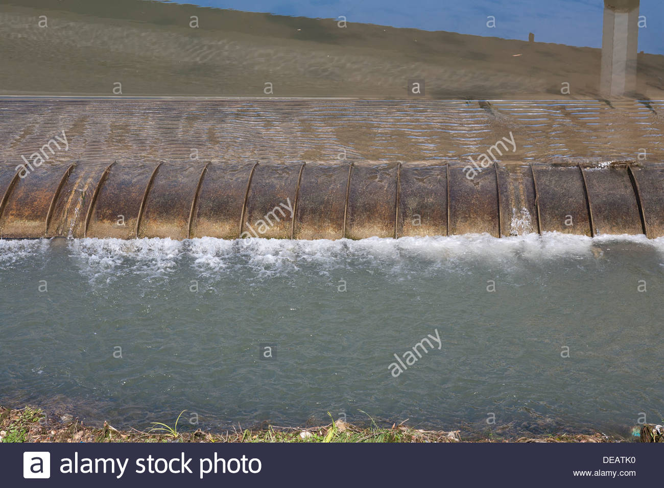 lowered sluice gate for flood protection on the Rio Nabão in the Town of Tomar central Portugal - Stock Image