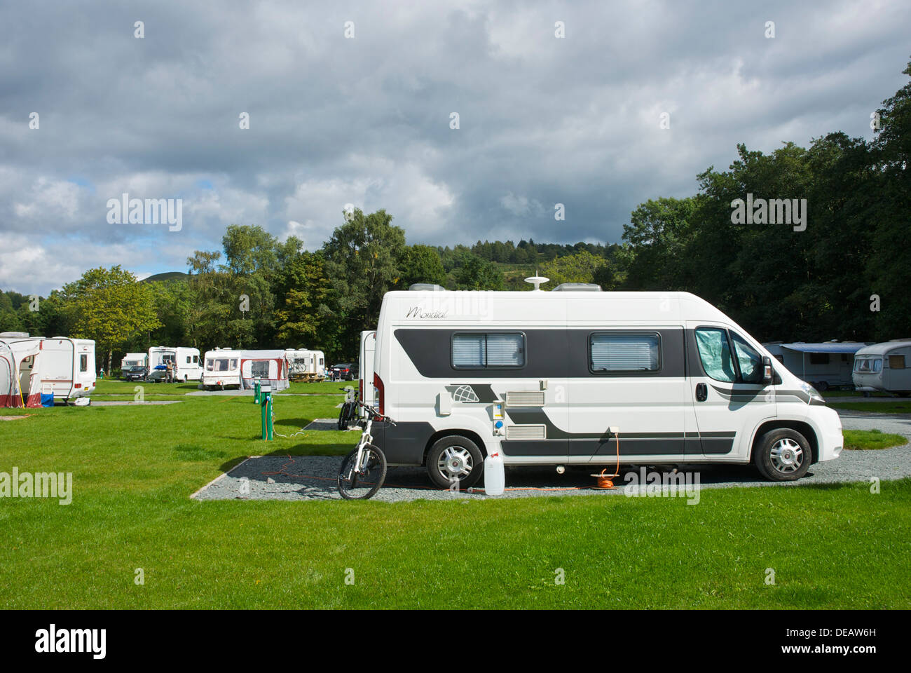 Motorhomes and caravans in the Croft Campsite, Hawkshead, Lake District National Park, Cumbria, England UK - Stock Image