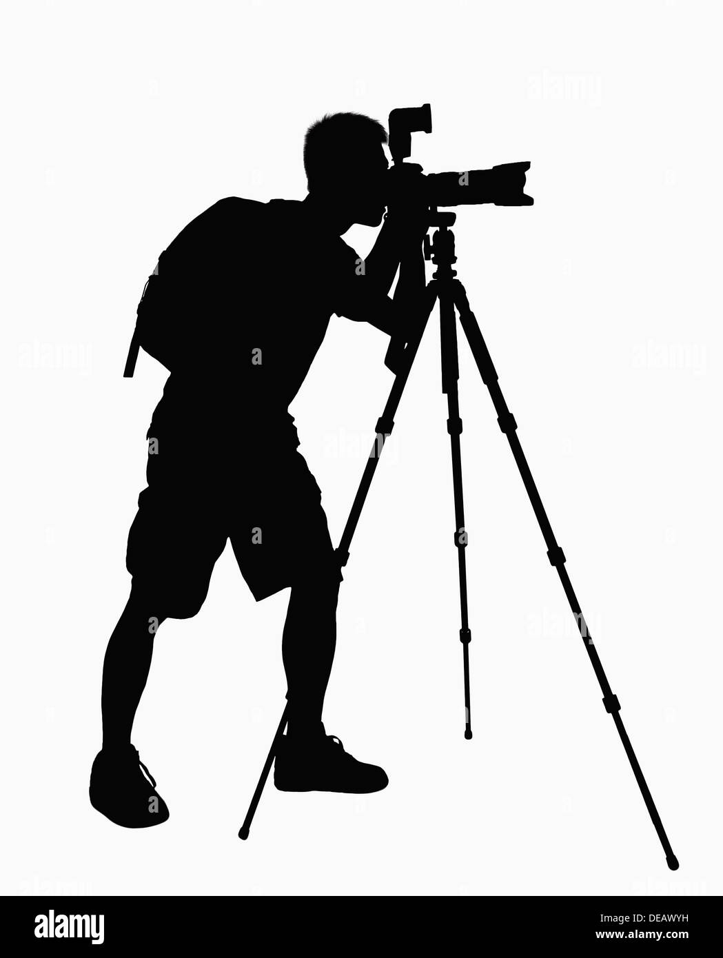 Silhouette of man taking pictures with camera on tripod #0: silhouette of man taking pictures with camera on tripod DEAWYH