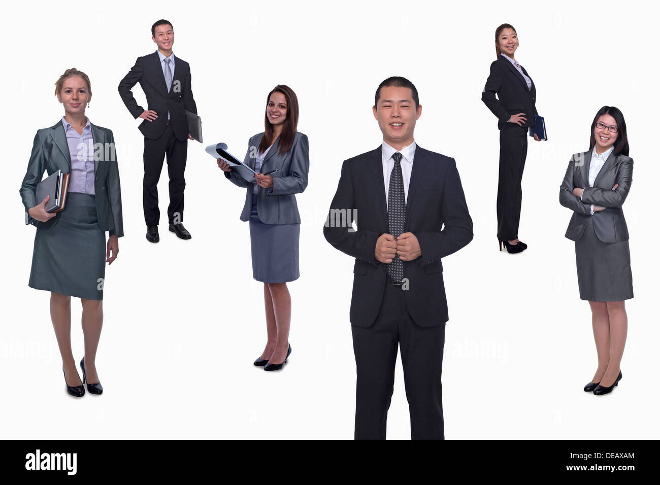 Medium group of smiling business people, portrait, full length, studio shot Stock Photo