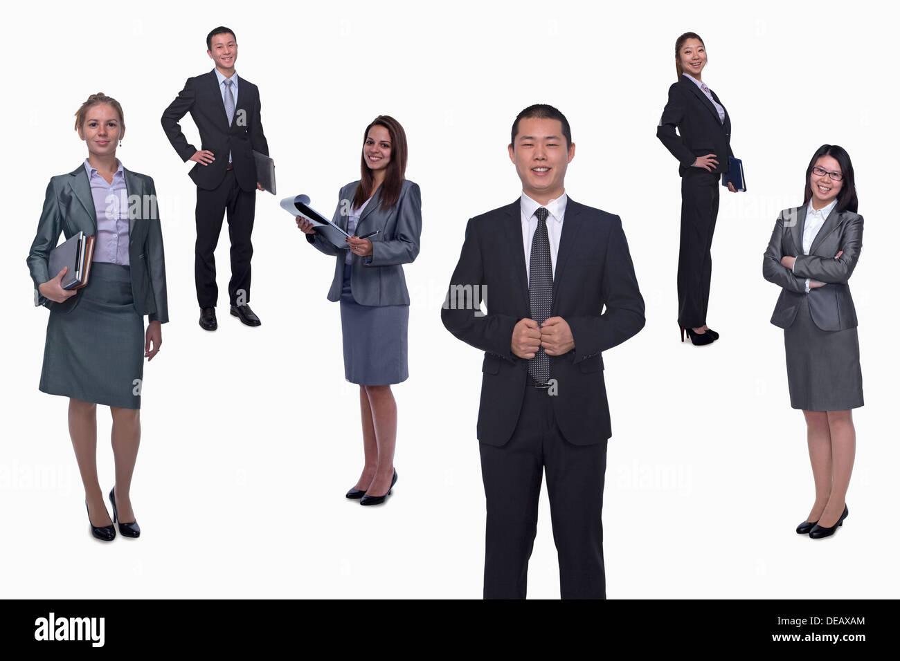 Medium group of smiling business people, portrait, full length, studio shot - Stock Image