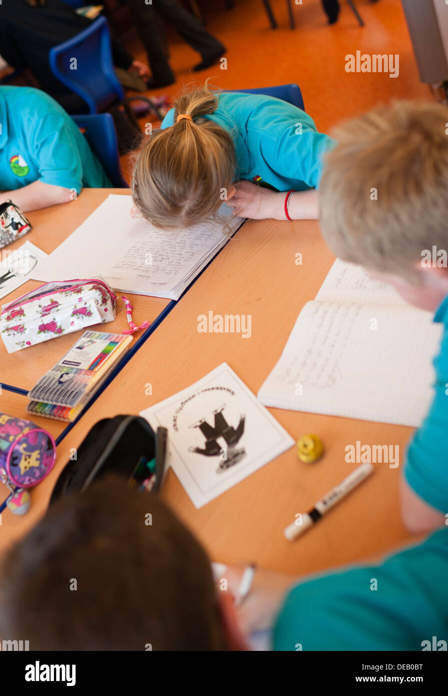 Pupils working during a lesson in a primary school, Wales UK - Stock Image
