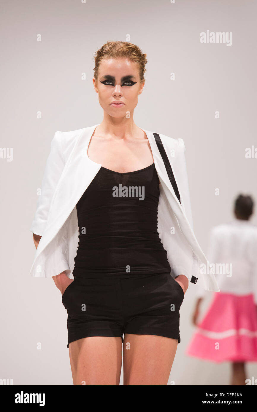 London, UK. 15 September 2013.  A model walks the runway at the House of Evolution fashion show during London Fashion Week at Fashion Scout/Freemason's Hall. Collection by Josh & Nicol. Photo: CatwalkFashion/Alamy Live News - Stock Image
