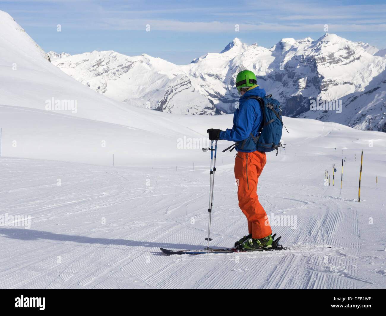 Skier skiing on 14 km blue piste Les Cascades in Grand Massif ski area in French Alps. Flaine, Haute Savoie, Rhone-Alpes, France - Stock Image