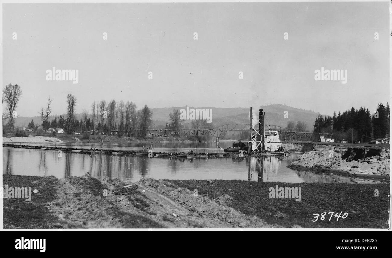 View looking north showing 15 suction dredge excavating at channel changge of Lewis River, at right of Station 848 298236 - Stock Image