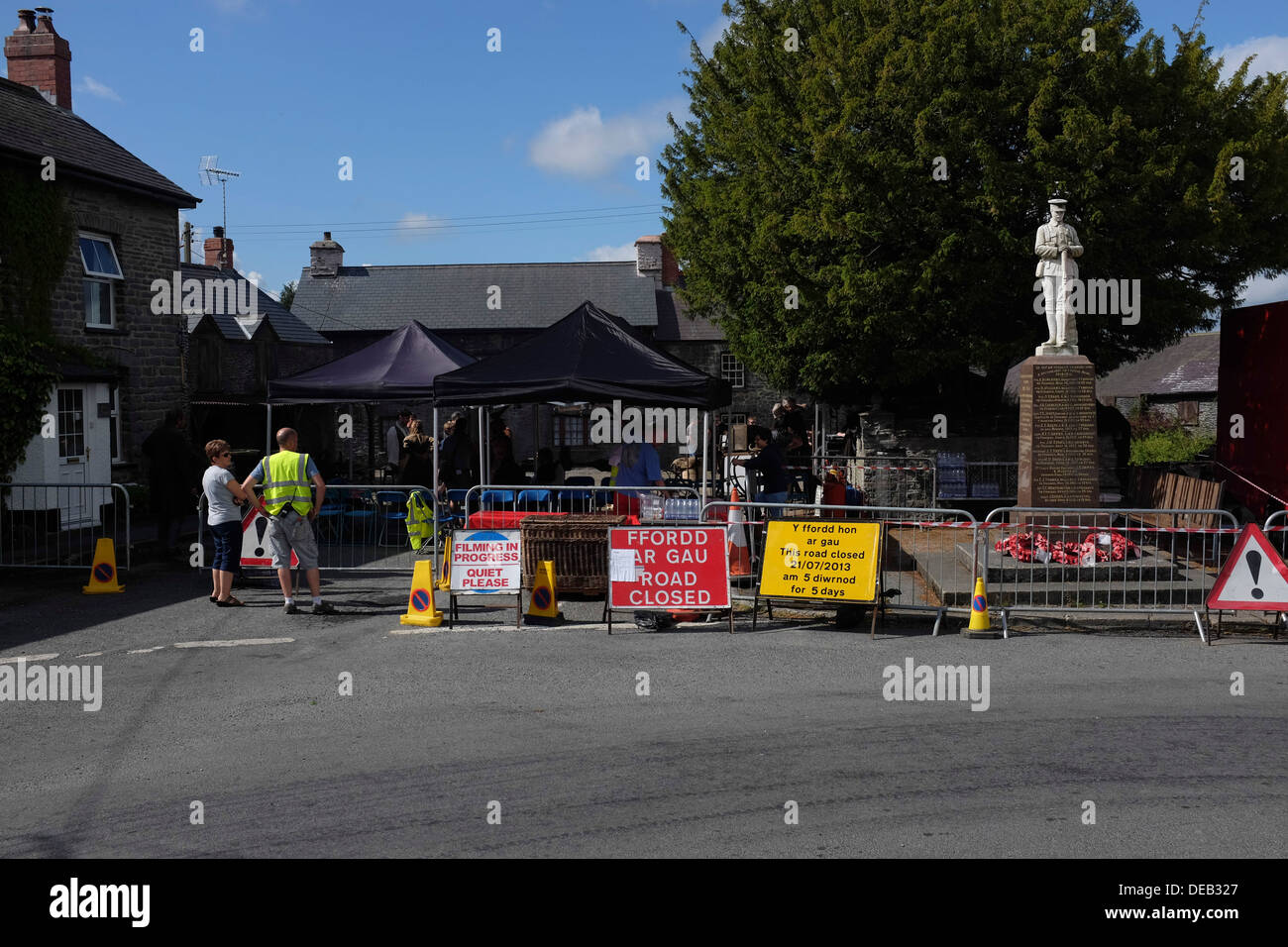 Signs for a road closure at a film location, in a village in Wales , UK - Stock Image