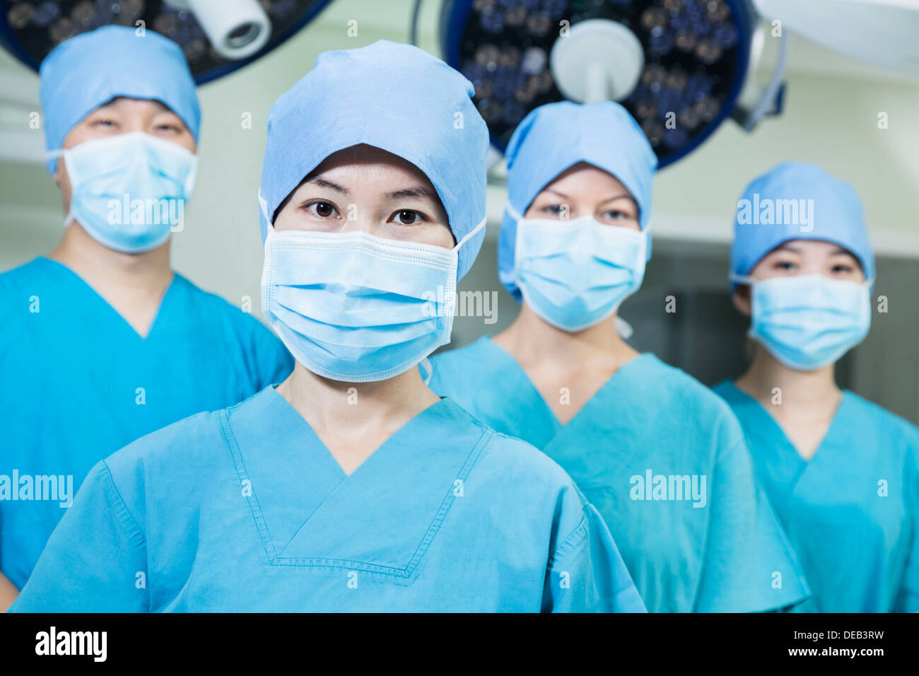 In Room Team Wearing Of Operating The Surgeons Surgical Masks