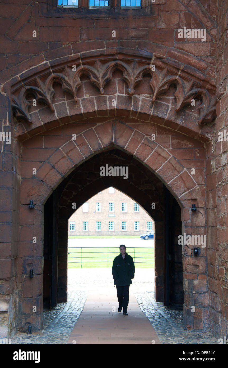 Man walking through the Captain's Tower Carlisle Castle, Carlisle Cumbria England United Kingdom. - Stock Image