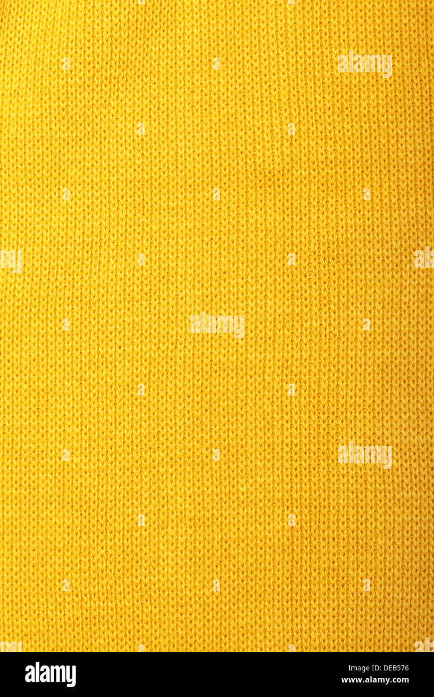 Yellow knitted wool background - Stock Image