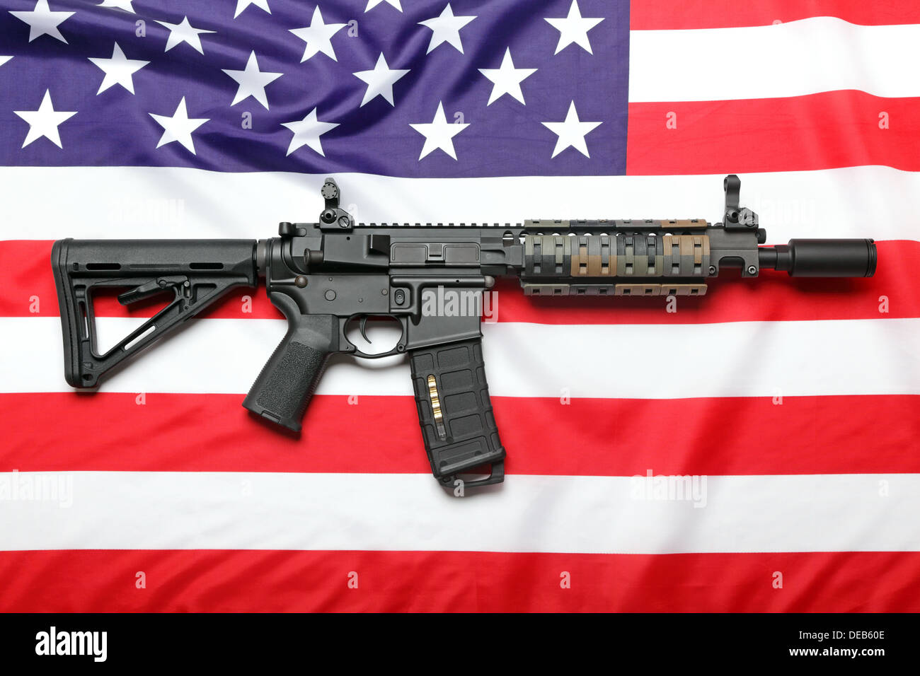 The 'Black Rifle' AR15 carbine and the flag of USA - Stock Image