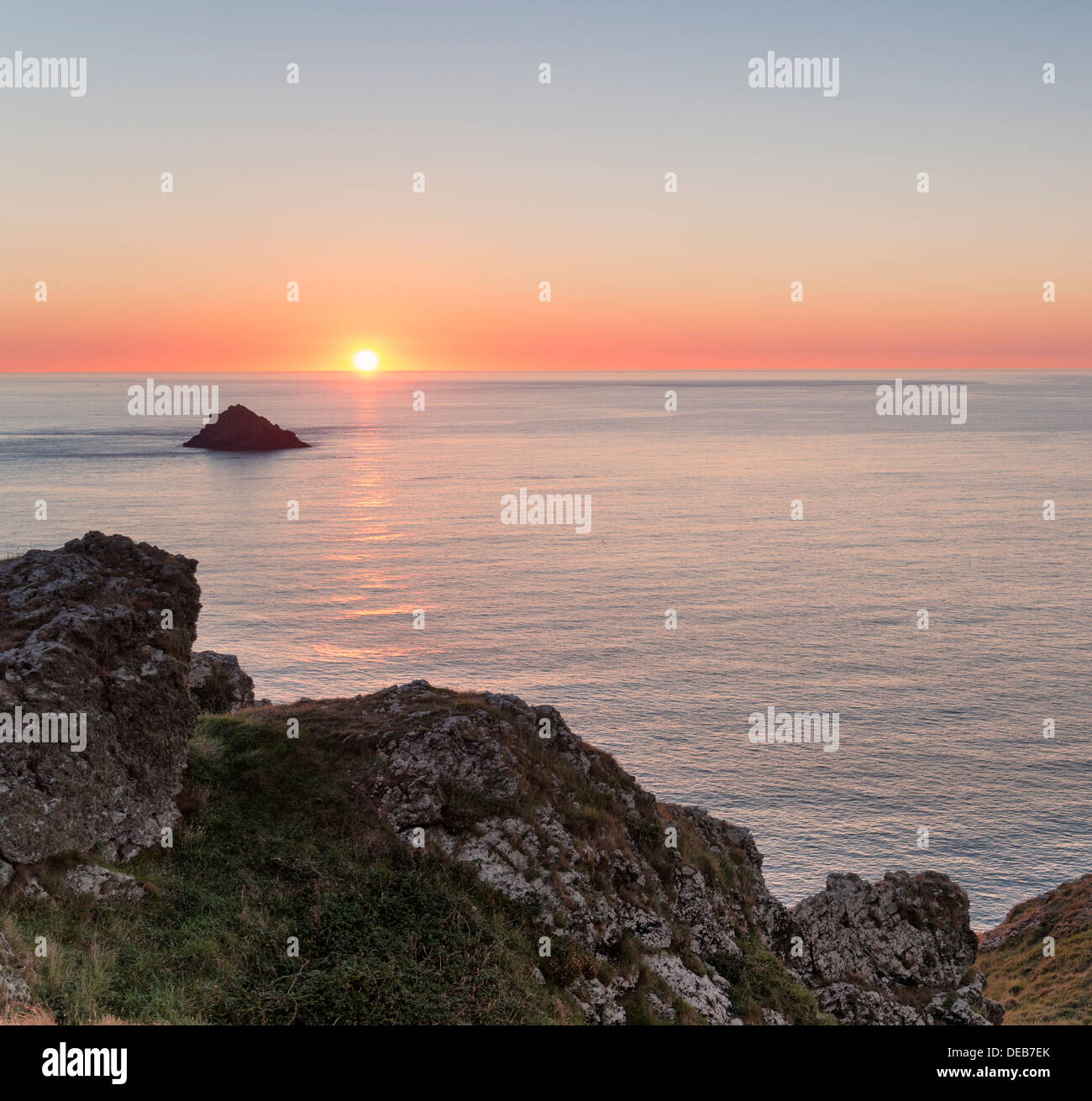 Sunset over the Rumps on Pentire Headland on Cornwall's Atlantic coast - Stock Image