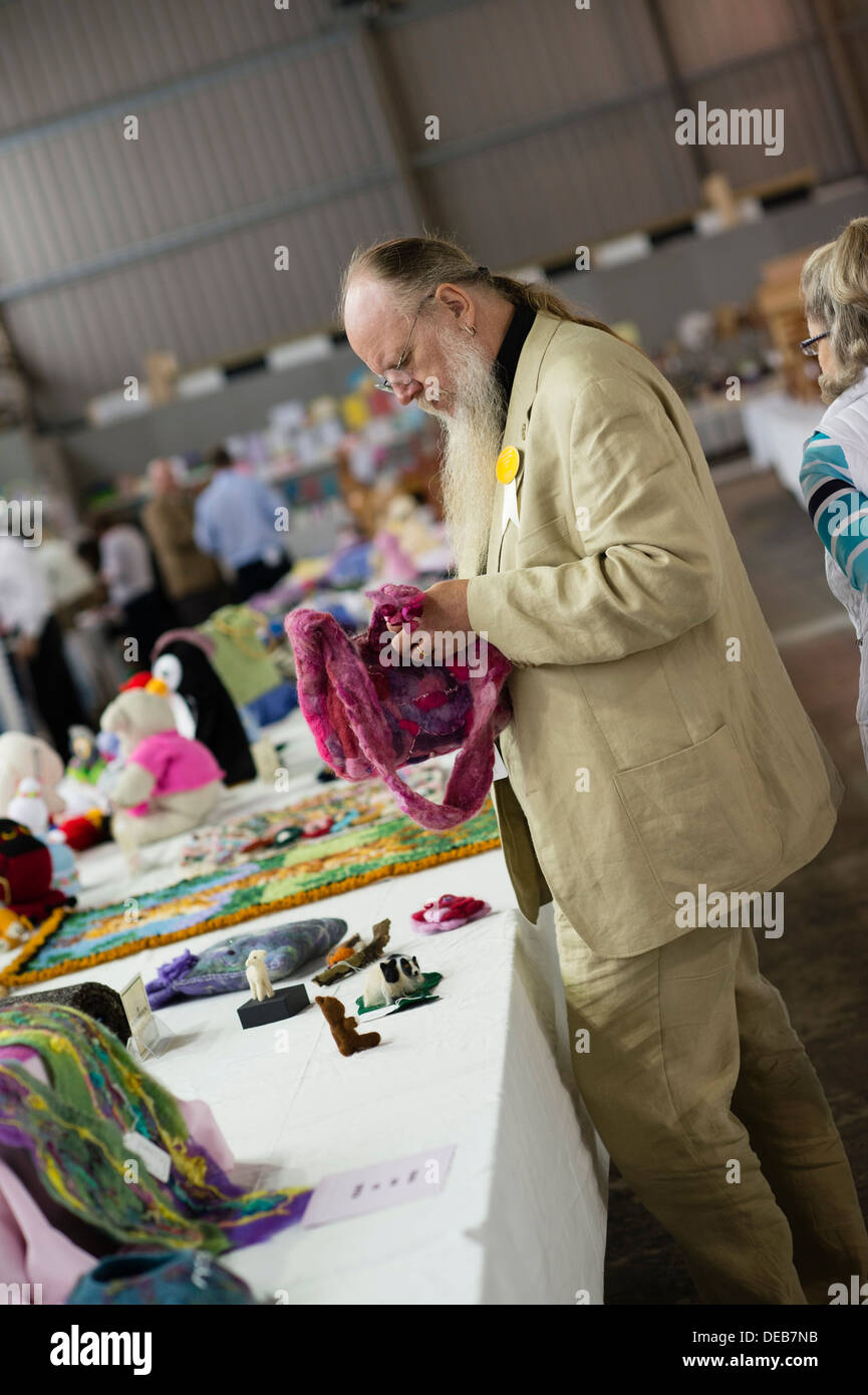A man judging handicrafts at the Pembrokeshire agricultural show