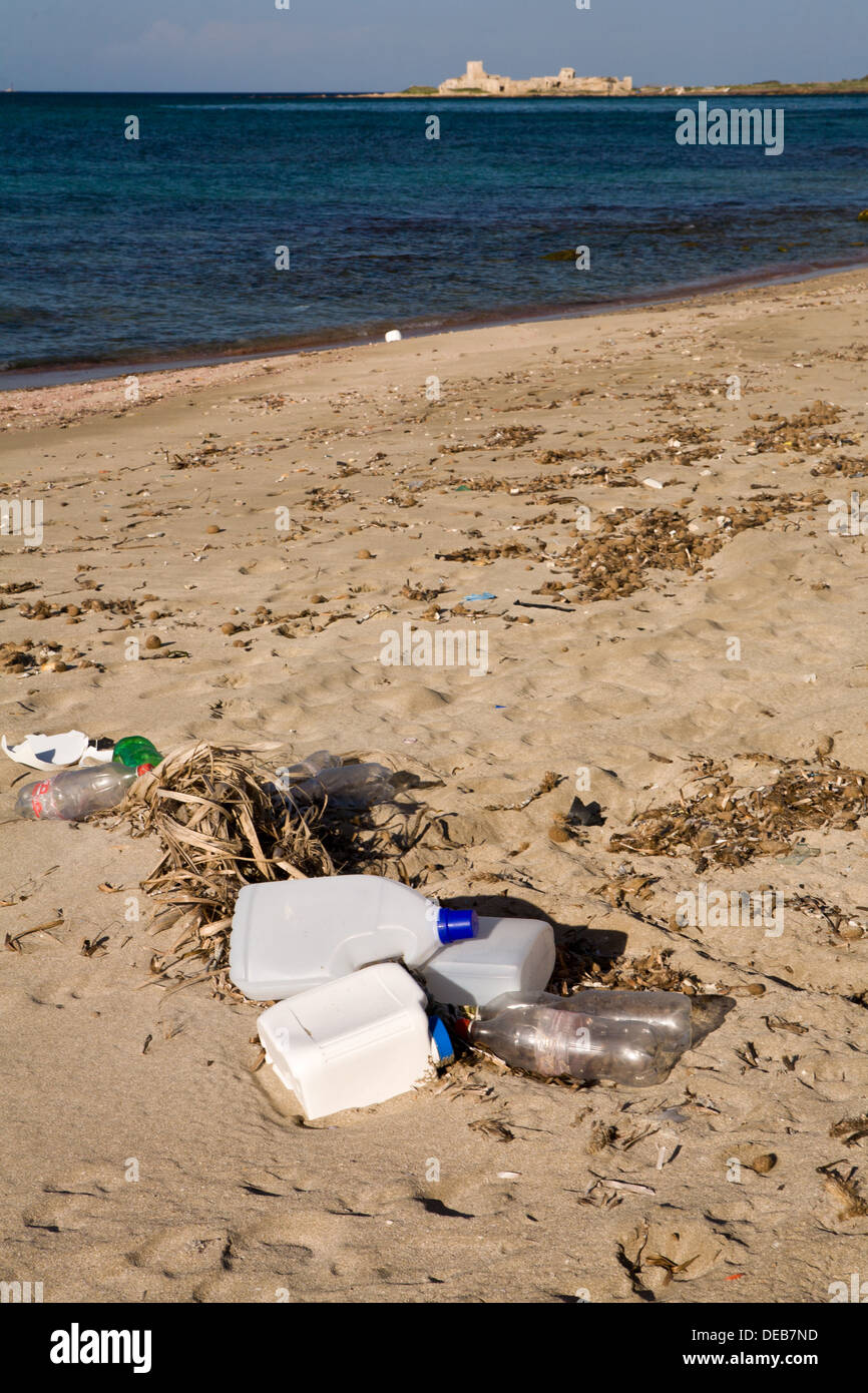 Human trash discarded on a beech in Trapani in the Province of Trapani, Sicily. - Stock Image