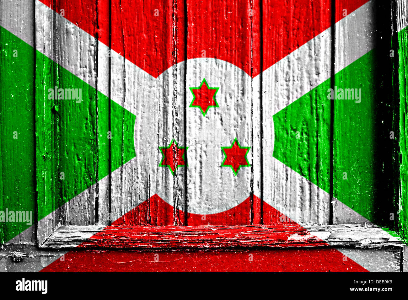 flag of burundi painted on a wooden frame - Stock Image