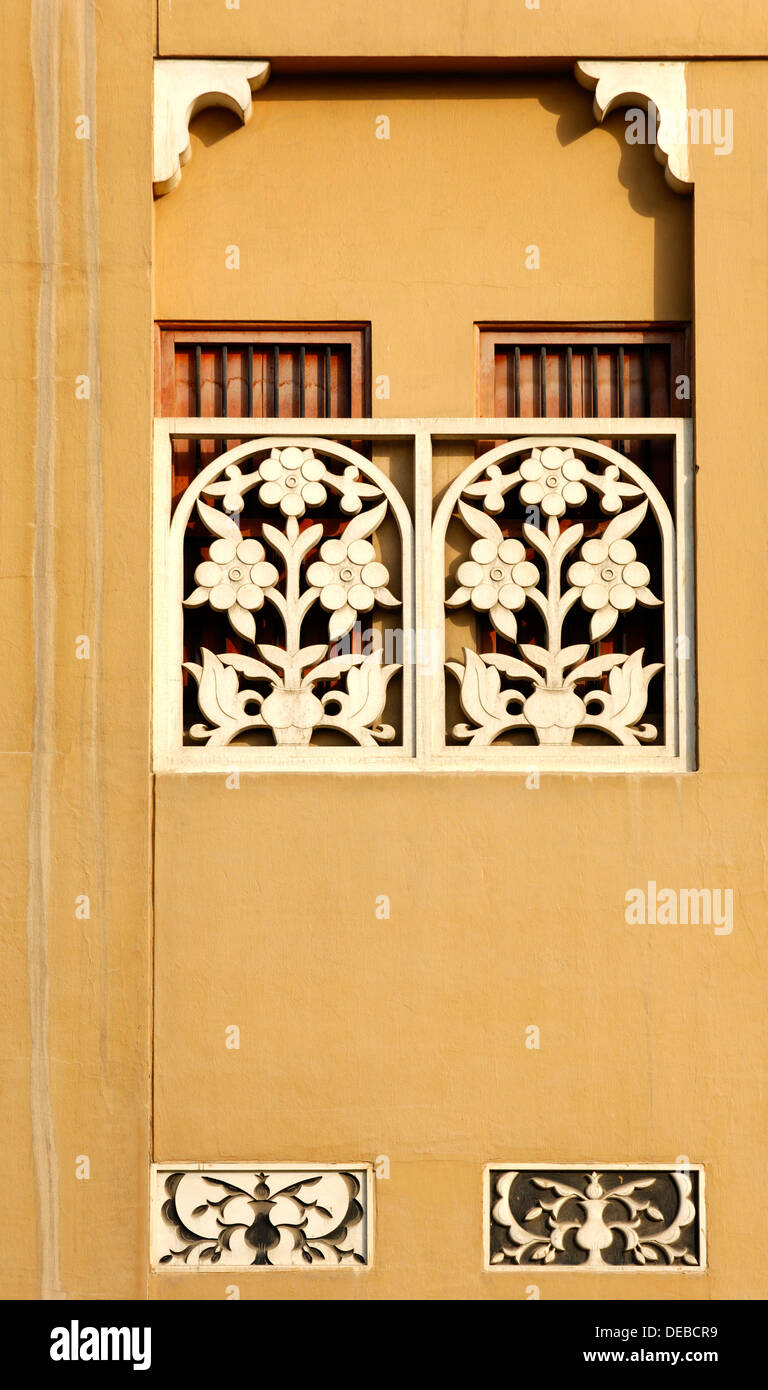 Ornamental carved window decoration on a traditional house in the Al ...