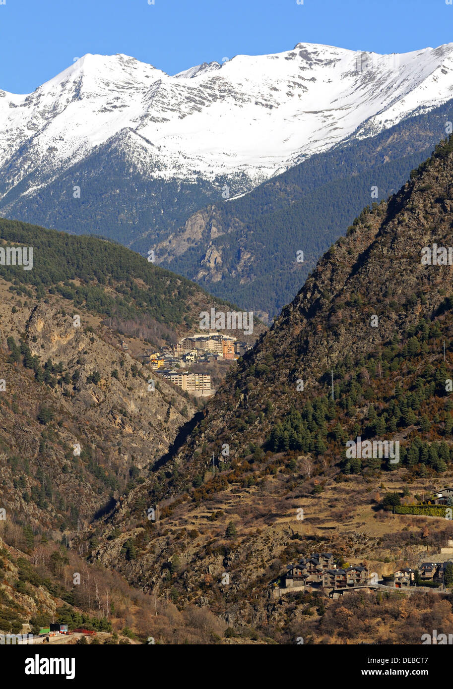 View from La Plana in Andorra La Vella looking north towards the remote mountain village of Sispony in front of the snow-capped - Stock Image