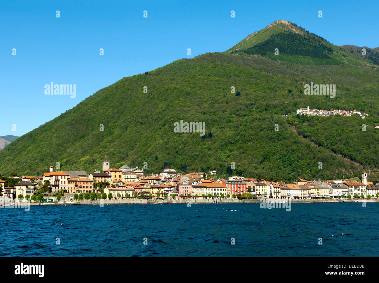 Cannobio on Lake Maggiore with the hamlet of Sant'Agata in a deciduous forest on a mountain slope, Cannobio, Piedmont - Stock Image