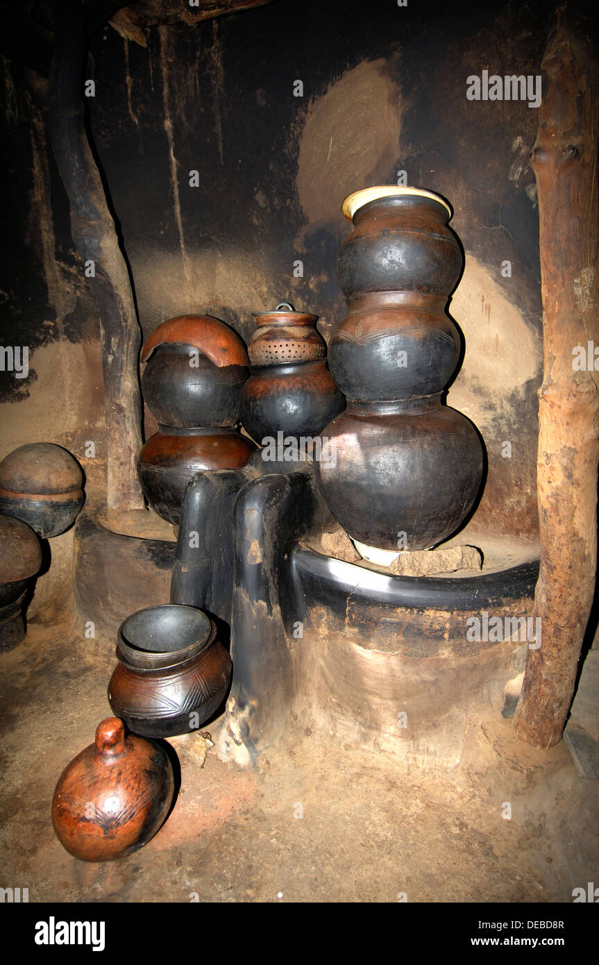 Pots and kitchen equipment in an African hut, Tiebele, Burkina Faso - Stock Image