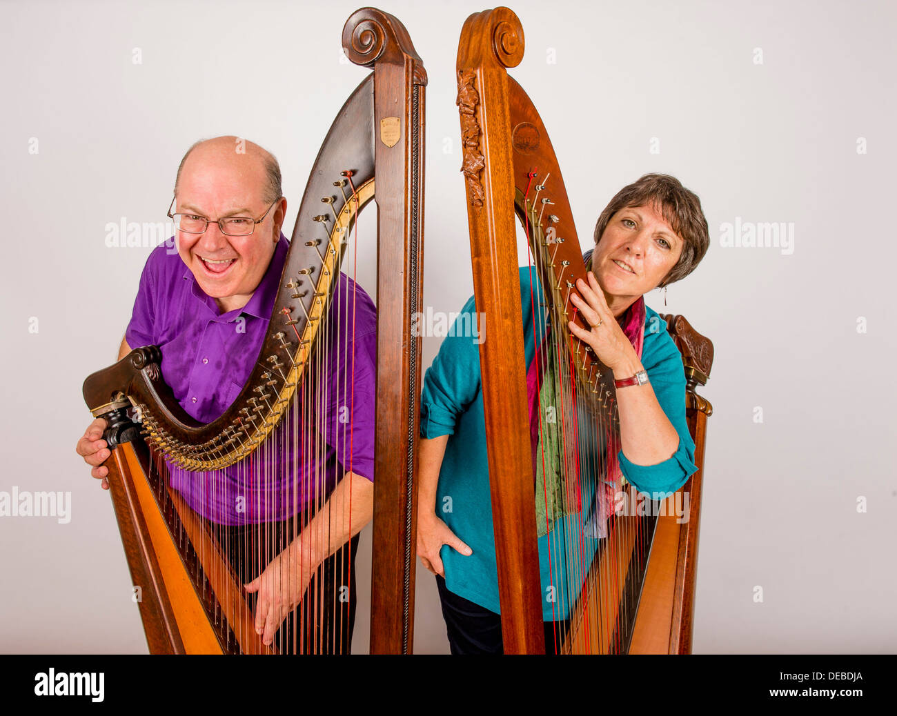 Two Welsh traditional harpists folk musicians Rhiain Bebb and Robin Huw Bowen - Stock Image