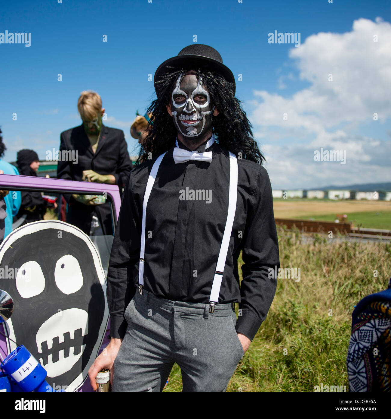 A man in a Mighty Boosh black face fancy dress at the annual Borth village carnival Ceredigion Wales UK - Stock Image