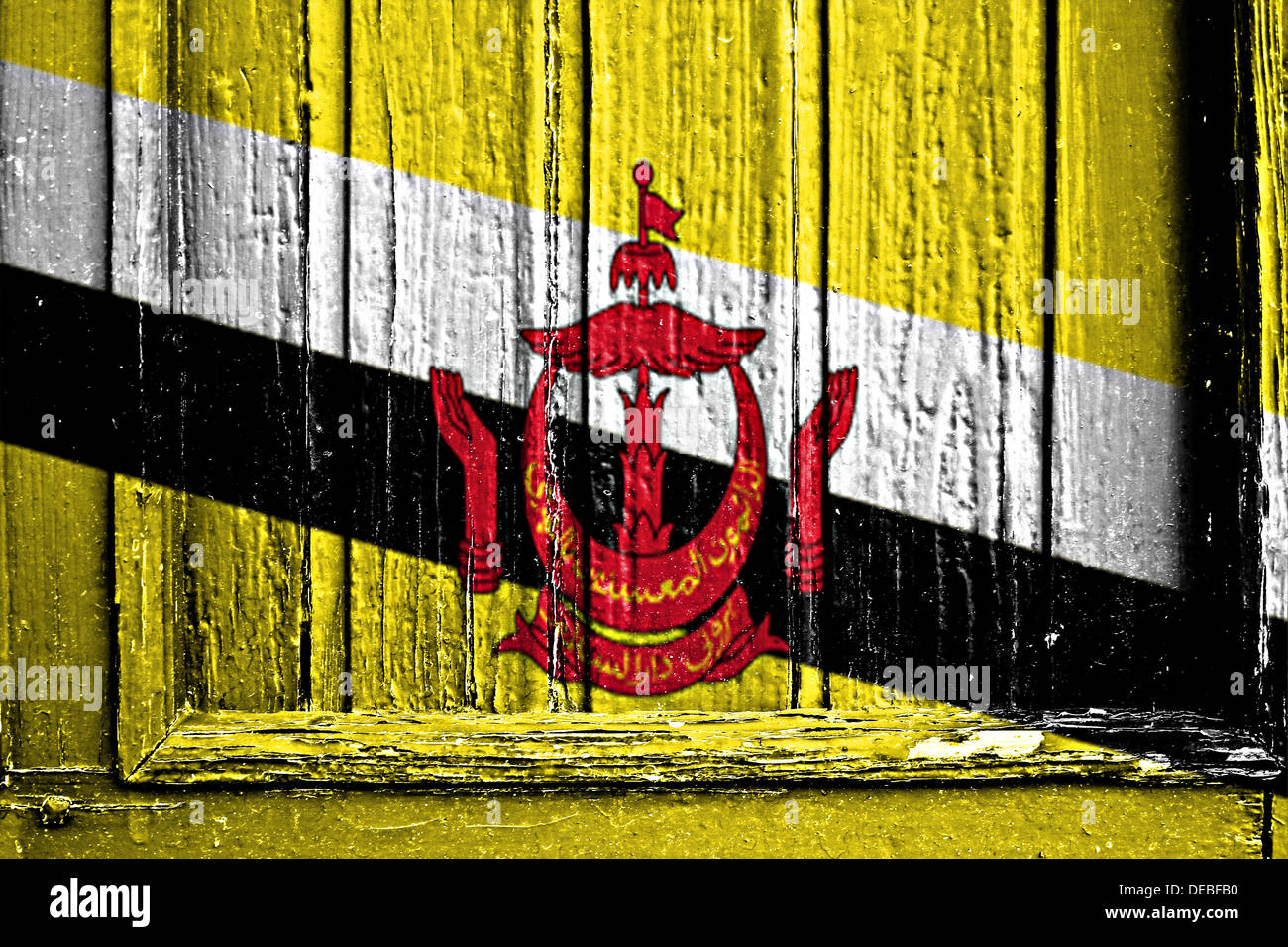 flag of Brunei painted on a wooden frame - Stock Image