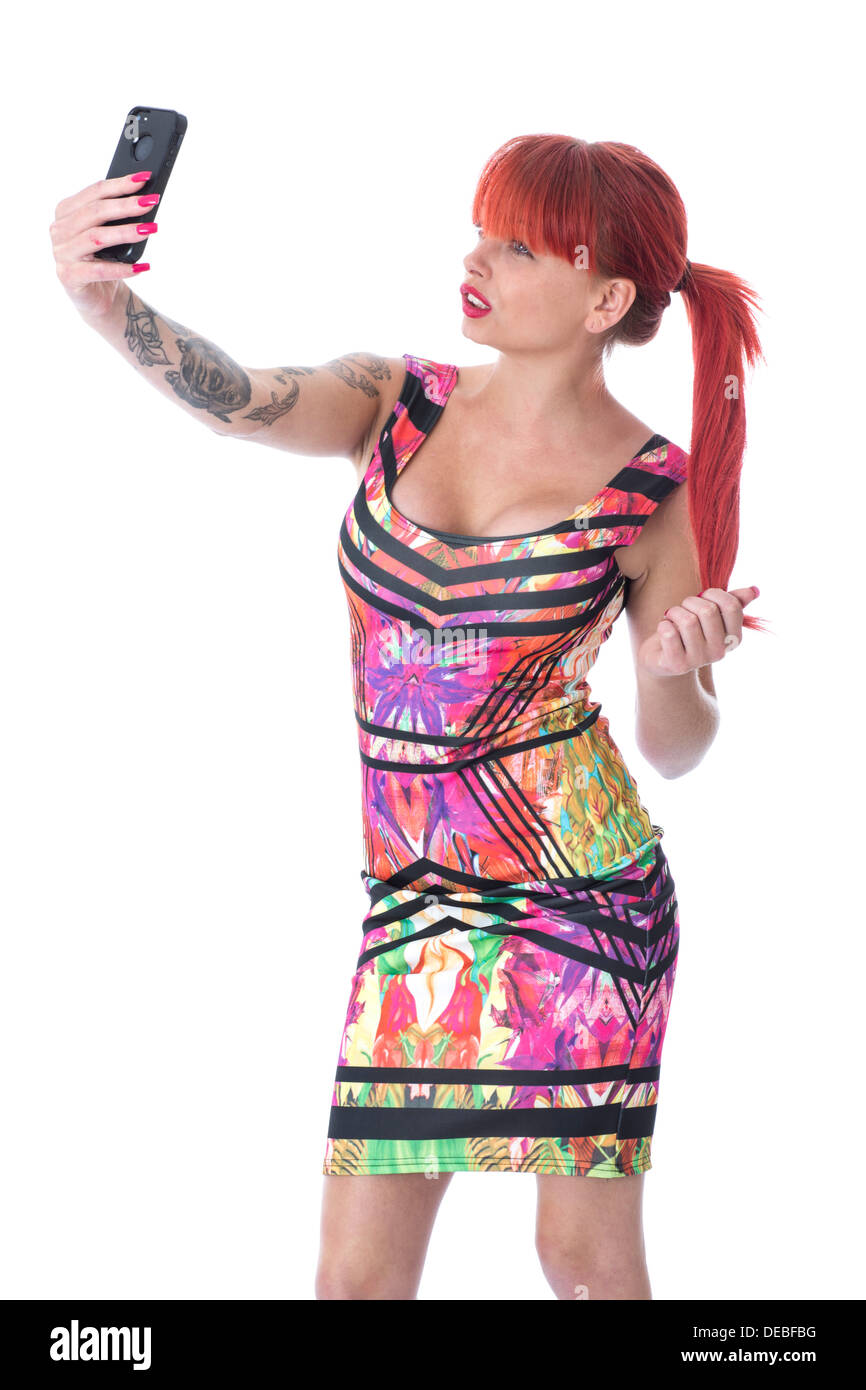 Model Released. Attractive Young Woman Taking Selfy Photograph - Stock Image