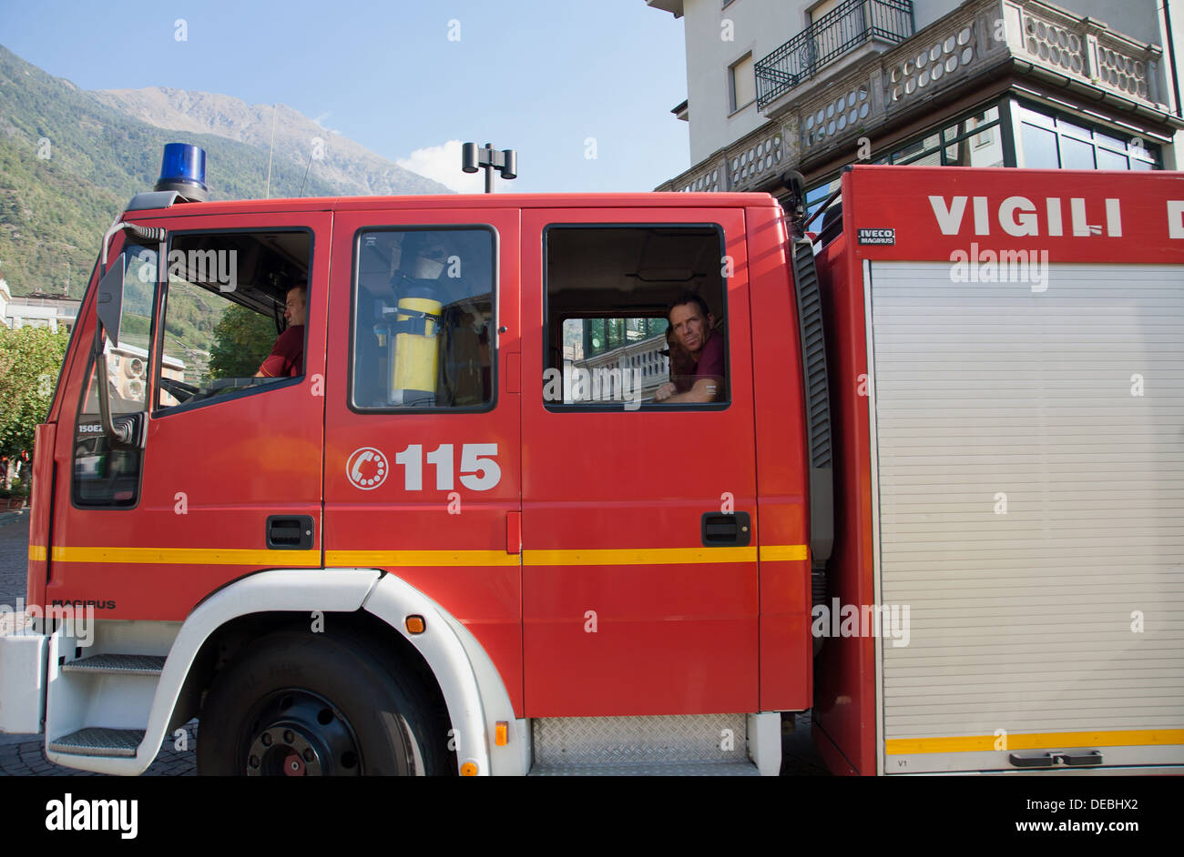 Tirano, Italy, a fire truck drives past - Stock Image